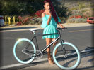 Christina Milian with a Bike wearing Mini Dress