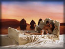 Olivia Wilde on the Bed in Lavazza Advert