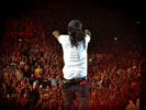 Lil Wayne on the Stage, a Crowd of Cheering Fans