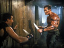 "Arnold Schwarzenegger in the movie ""Commando"" as John Matrix"