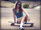 Teravena Sugimoto on a Skateboard wearing blue Sunglasses